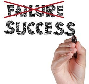 hand crossing out failure and writing success